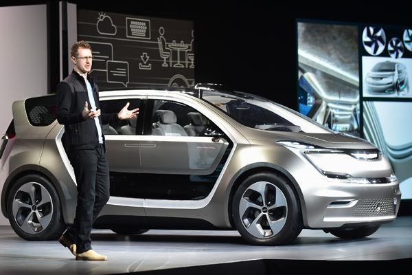 Exterior designer Matt Dunford speaks beside the unveiled Fiat Chrysler Portal Concept car during the Fiat Chrysler press conference at the 2017 Consumer Electronics Show (CES2017) in Las Vegas, Nevada, on January 3, 2017. Frederic J. BROWN / AFP